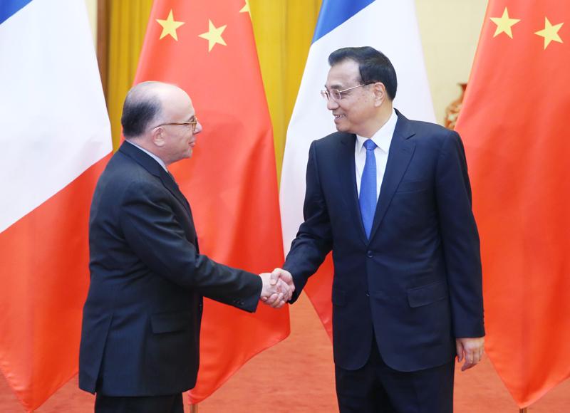 李克强接待法国总理访华时强调:以稳定性应对不确定性